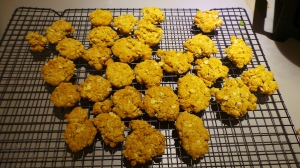 Anzac Biscuits cooling on a rack after baking
