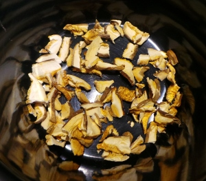 Break up the dried mushrooms and place a single layer on the bottom of your pot.