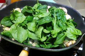 Waiting for the spinach to wilt.