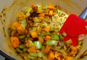 Mix the paste through the vegetables, breaking up any lumps.
